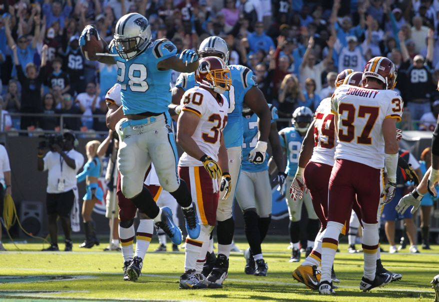 Carolina Panthers' Jonathan Stewart (28) celebrates his touchdown run against the Washington Redskins during the third quarter of an NFL football game in Charlotte, N.C., Sunday, Oct. 23, 2011. (AP Photo/Bob Leverone)