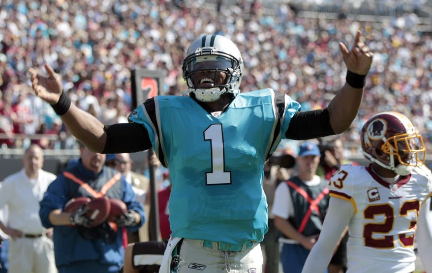 Carolina Panthers rookie quarterback Cam Newton threw for a touchdown and ran for a touchdown in the panthers' 33-20 win over the Washington Redskins on Sunday. Newton went 18-for-23 passing for 256 yards and had 59 yards on the ground. (AP Photo/Chuck Burton)