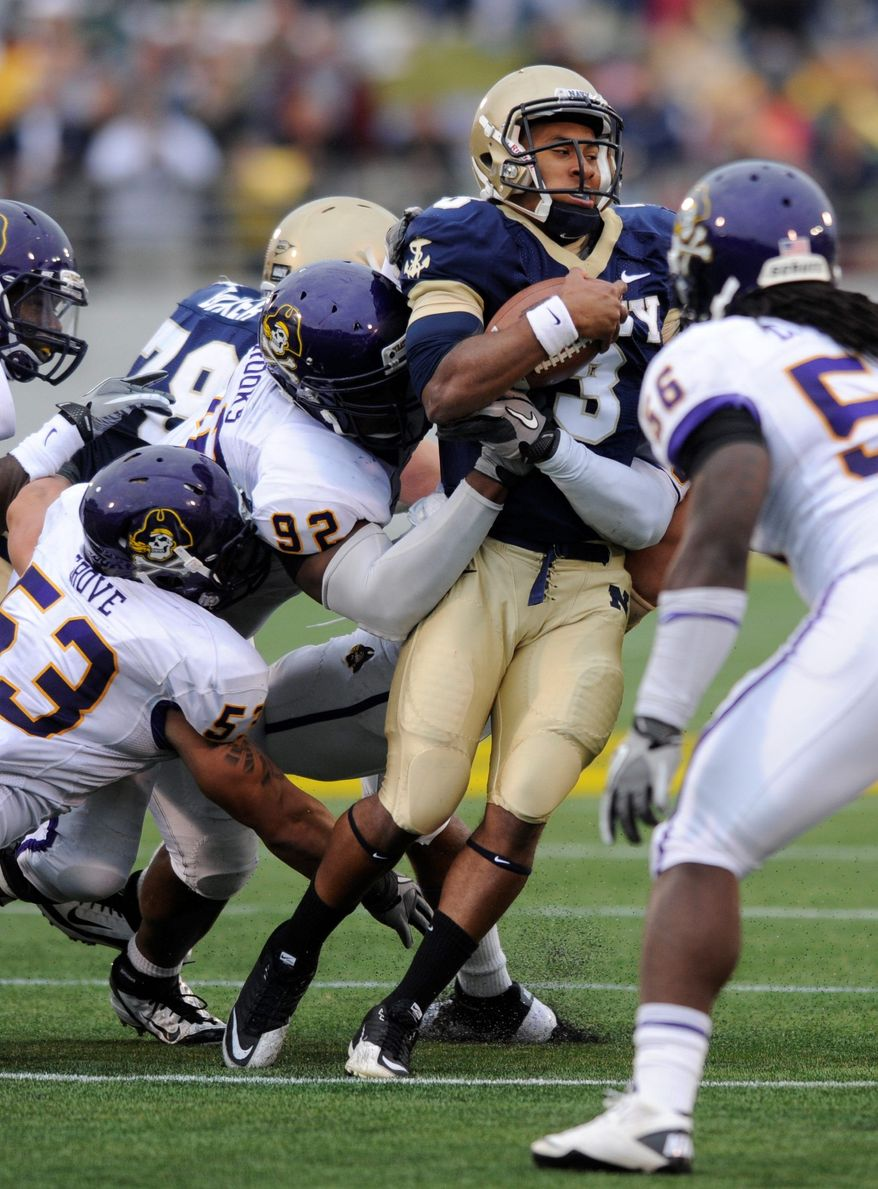 Navy quarterback Trey Miller passed for two touchdowns against East Carolina on Saturday, but the Midshipmen still came up short. (Associated Press)