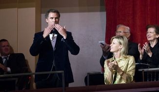 Actor-comedian Will Ferrell, who on Sunday, Oct. 23, 2011, received the Mark Twain Prize, the nation's top honor for humor, blows a kiss to the audience at the Kennedy Center for the Performing Arts in Washington. (AP Photo/Kevin Wolf)