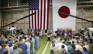 U.S. Secretary of Defense Leon E. Panetta speaks to American service members at Yokota Air Base in Fussa, Japan, west of Tokyo, on Monday, Oct. 24, 2011. (AP Photo/Koji Sasahara)