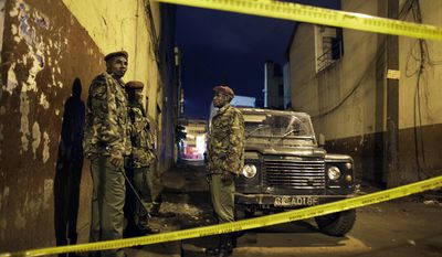 Kenyan police guard the scene of a suspected grenade blast at a pub in downtown Nairobi, Kenya, on Oct. 24, 2011. The blast wounded more than a dozen people, a police official said. (Associated Press)