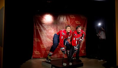 Alex Ovechkin of the Washington Capitals hockey team poses along side his Alex Ovechkin statue at Madame Tussauds as it is unveiled, Washington, DC, Monday, October 24,  2011. (Andrew Harnik / The Washington Times)