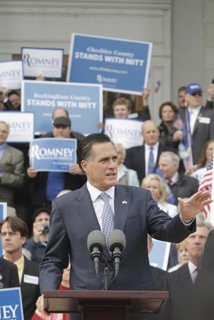 Republican presidential candidate and former Massachusetts Gov. Mitt Romney talks to supporters in front of the State House in Concord, N.H., on Oct. 24, 2011, after filing his papers to be on the ballot for the state's presidential primary. (Associated Press)