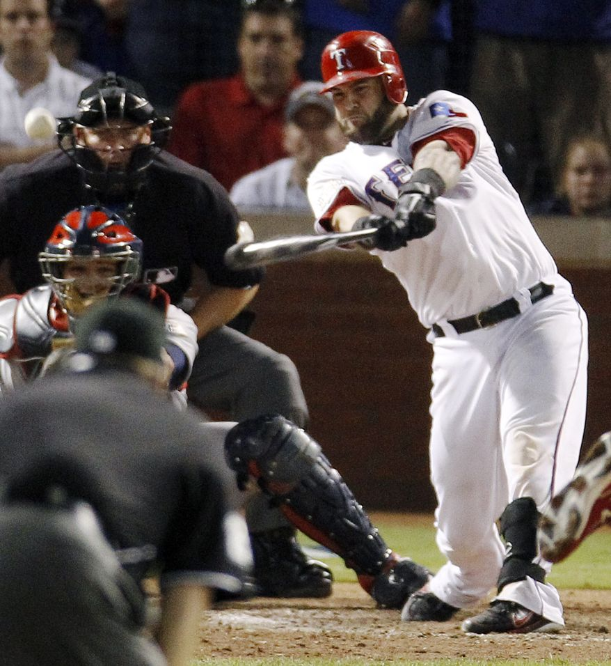 Texas Rangers' Mike Napoli hits a two-RBI double off St. Louis Cardinals' Marc Rzepczynski during the eighth inning of Game 5 of baseball's World Series Monday, Oct. 24, 2011, in Arlington, Texas. (AP Photo/Eric Gay)