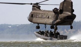 """A CH-47 Chinook helicopter, like this one used for training, was shot down by the Taliban in Afghanistan, killing all aboard. A special-operations officer questions the use of the craft for such """"hot-LZ"""" purposes. (U.S. Navy photograph via Associated Press)"""
