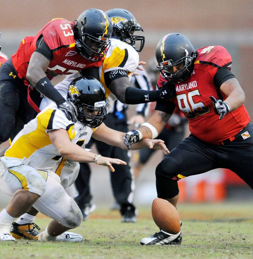 ** FILE ** Maryland defensive tackle A.J. Francis, looking to pounce on a fumble in the Terrapins' win over Towson on Oct. 1, sees 1600 Pennsylvania Ave. as his future address. (Associated Press)