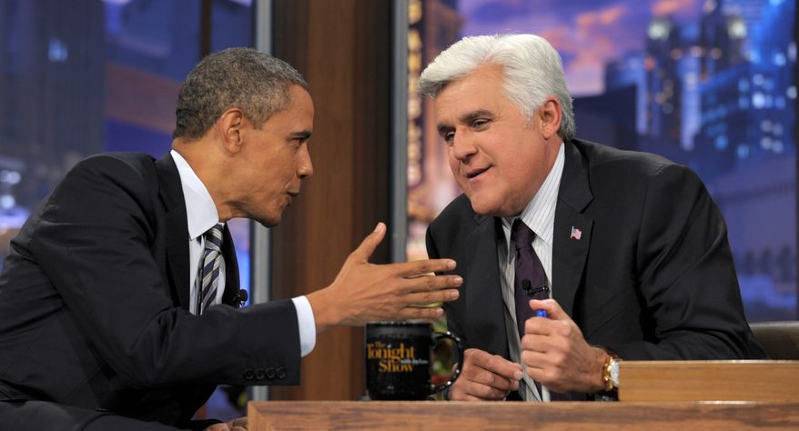 """President Obama talks with his host between segments of an interview Tuesday on """"The Tonight Show With Jay Leno."""" Mr. Obama said he isn't paying very close attention to the GOP primary debates yet. He also addressed the recent killing for Libyan leader Moammar Gadhafi and the NBA lockout. (Associated Press)"""