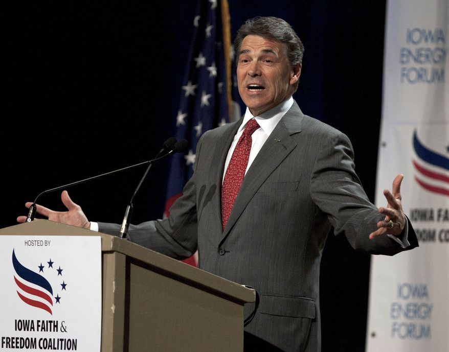 Texas Gov. Rick Perry, who is running for the Republican presidential nomination, speaks at the Iowa Faith & Freedom Coalition presidential candidate forum in Des Moines, Iowa, on Saturday, Oct. 22, 2011. (AP Photo/Nati Harnik)