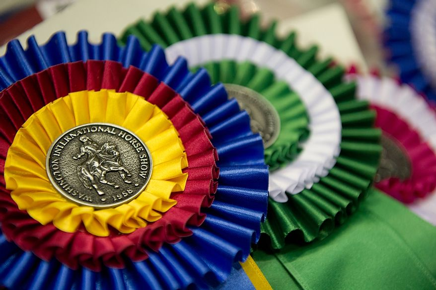 Ribbons wait to be placed on winning horses at the annual Washington International Horse Show on Oct. 25, 2011, in D.C. The event runs Oct. 25-30 at the Verizon Center and features top riders and horses competing from the U.S. and abroad. (Andrew Harnik/The Washington Times)