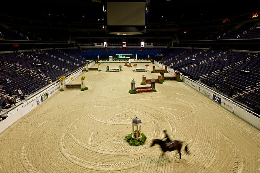 """Liza Boyd of Los Angeles rides her horse """"Arcadia"""" on the first day of the annual Washington International Horse Show on Oct. 25, 2011, in D.C. The event runs Oct. 25-30 at the Verizon Center and features top riders and horses competing from the U.S. and abroad. (Andrew Harnik/The Washington Times)"""