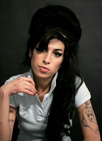British singer Amy Winehouse was found dead in her home on July 23. A coroner said she died of accidental alcohol poisoning when she resumed drinking after weeks of abstinence. (Associated Press)