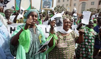Supporters of Col. Moammar Gadhafi in Bamako, Mali, rally in March in support of the longtime Libyan leader, whose regime was under siege by rebels at the time. Many in Mali mourned the Oct. 20 death of Gadhafi, who was captured and killed by the rebels, because Mali was one of many African nations on which he had lavished some of Libya's oil wealth.  (Associated Press)