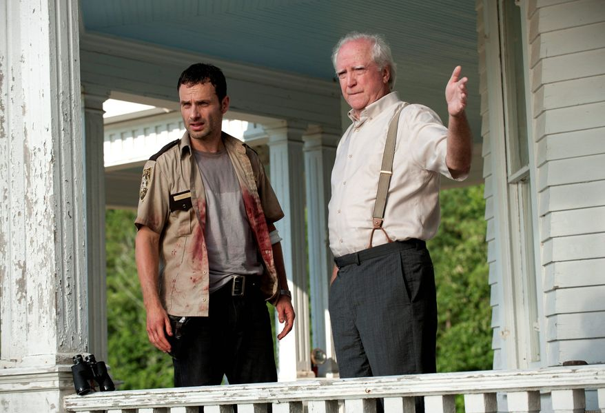 """Andrew Lincoln (left) and Scott Wilson deal with a """"zombie apocalypse"""" in AMC's """"The Walking Dead,"""" which has been renewed for a third season. (AMC via Associated Press)"""