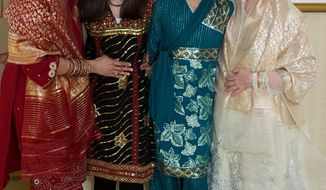 """Gita Deane (left) and Lisa Polyak (right) are shown at their wedding in Washington with their daughters, Maya (center left), 15, and Devi, 12. Ms. Polyak is chairwoman of the statewide gay-rights group Equality Maryland. """"The root of my activism is denial of equal treatment of my children,"""" she said. (Associated Press)"""