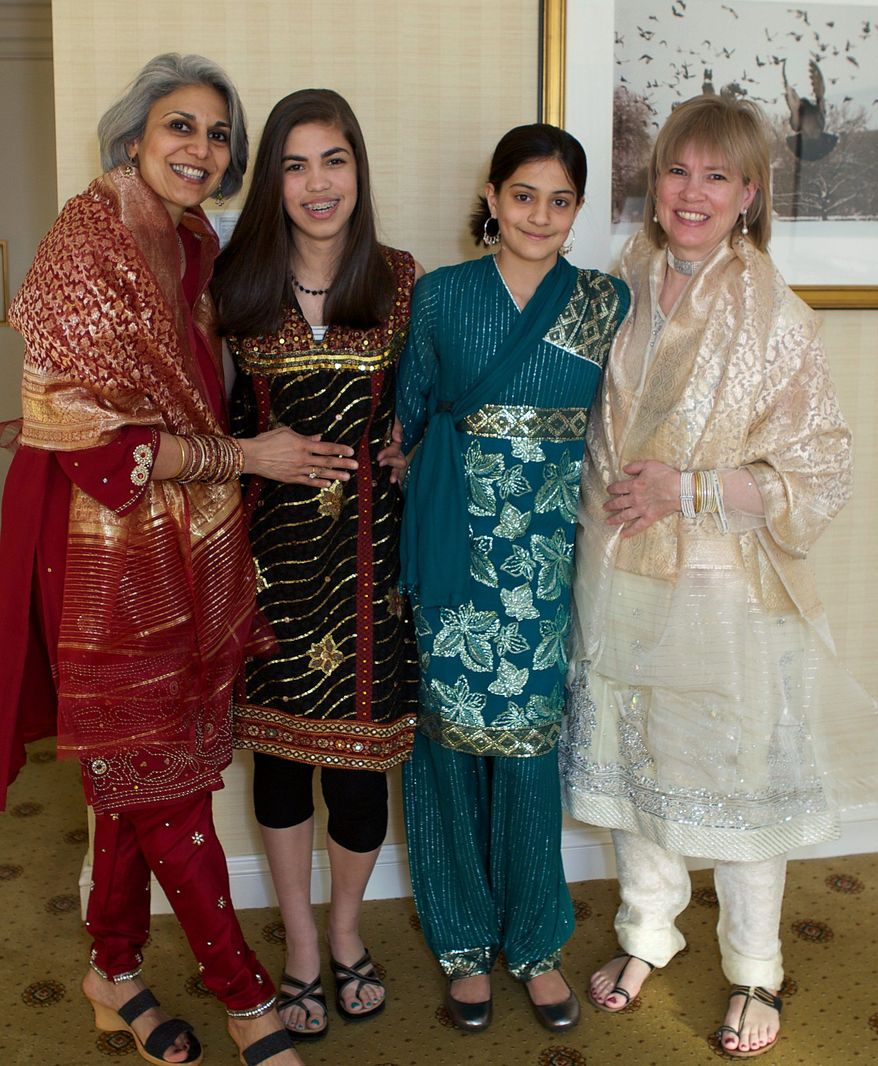 "Gita Deane (left) and Lisa Polyak (right) are shown at their wedding in Washington with their daughters, Maya (center left), 15, and Devi, 12. Ms. Polyak is chairwoman of the statewide gay-rights group Equality Maryland. ""The root of my activism is denial of equal treatment of my children,"" she said. (Associated Press)"
