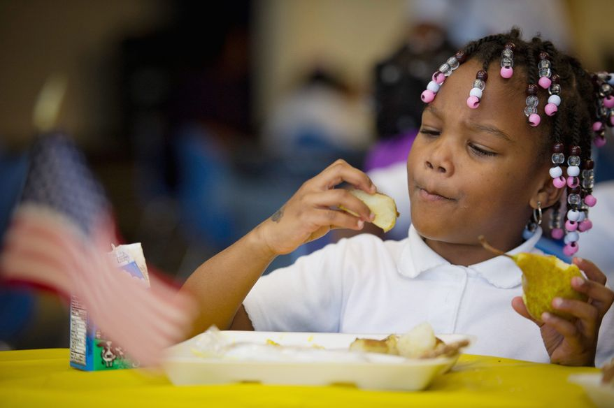Myrtilla Miner Elementary School student London Gray, 5, tries out some traditional Swedish food in the cafeteria as H.R.H. Prince Daniel of Sweden makes a visit to Myrtilla Miner Elementary School in Washington, D.C., Wednesday, October 26, 2011. The Embassies of Denmark, Finland, Iceland, Norway and Sweden along with the D.C. Public Schools Office of Food & Nutrition Services, the Office of Secretary for the District of Columbia and the DC Embassy Adoption Program, bring Nordic food to all 45,000 D.C. Public School students at 125 schools. (Rod Lamkey Jr./The Washington Times)