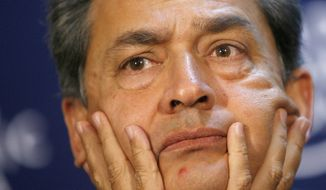** FILE ** Rajat Kumar Gupta, former chairman of the Global Fund to Fight AIDS, Tuberculosis and Malaria, listens during a session of the World Economic Forum in Davos, Switzerland, in January 2009. (AP Photo/Keystone/Alessandro Della Bella, File)