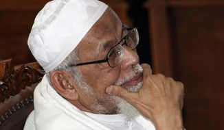 ** FILE ** Militant cleric Abu Bakar Bashir sits in the defendant's chair during his trial in a district court in Jakarta, Indonesia, on Thursday, June 16, 2011. (AP Photo/Achmad Ibrahim, FIle)