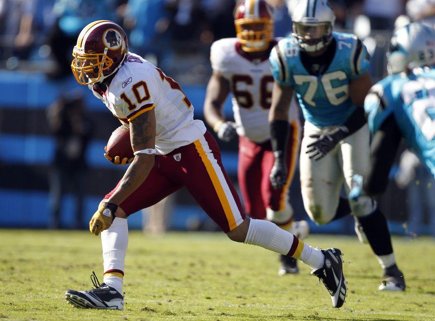 Washington Redskins' Jabar Gaffney (10) runs through the Carolina Panthers' defense during an NFL football game in Charlotte, N.C., Sunday, Oct. 23, 2011. The Carolina Panthers beat the Washington Redskins 33-20. (AP Photo/Bob Leverone)
