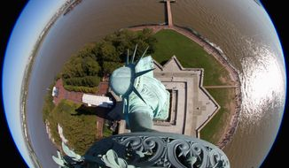 "Webcams will be switched on Friday during a ceremony to commemorate the 125th birthday of the Statue of Liberty. ""This is not your dad's picture of the Statue of Liberty,"" said Brian Cury (right), the founder of EarthCam. The New Jersey-based company donated the high-tech cameras, which will be activated continuously for Internet users around the world. (Associated Press)"