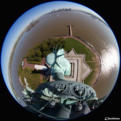 """Webcams will be switched on Friday during a ceremony to commemorate the 125th birthday of the Statue of Liberty. """"This is not your dad's picture of the Statue of Liberty,"""" said Brian Cury (right), the founder of EarthCam. The New Jersey-based company donated the high-tech cameras, which will be activated continuously for Internet users around the world. (Associated Press)"""