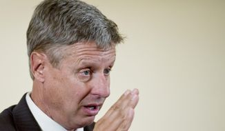 Republican presidential candidate Gary E. Johnson vows to submit a balanced budget his first year in the White House, a budget he said would amount to a 43 percent spending cut. (Rod Lamkey Jr./The Washington Times)