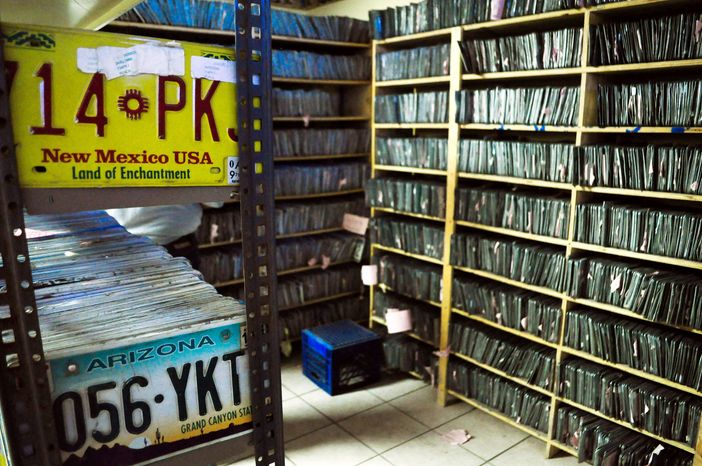 License plates taken from drivers who owe traffic fines are stored in a warehouse in Ciudad Juarez, Mexico. (Associated Press)