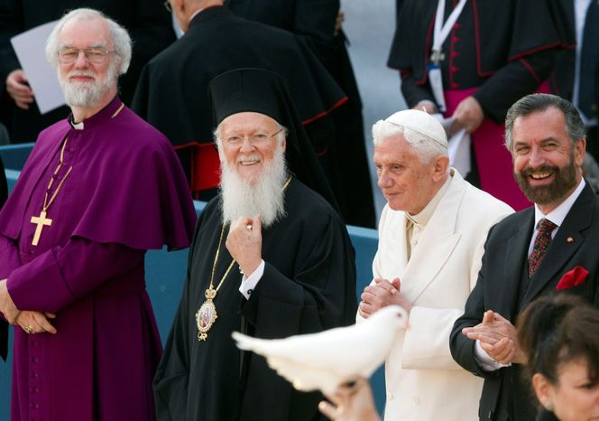 Archbishop of Canterbury Rowan Douglas Williams, Ecumenical Patriarch Bartholomew I, Pope Benedict XVI and Rabbi David Rosen look on as a person holds a dove prior to releasing it during a peace meeting in front of the St. Francis Basilica in Assisi, central Italy, on Thursday. (Associated Press)