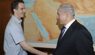 Israeli Prime Minister Benjamin Netanyahu (right) greets freed American-Israeli citizen Ilan Grapel in Jerusalem on Thursday, Oct. 27, 2011. (AP Photo/Israeli Government Press Office, Amos Ben Gershom, HO)