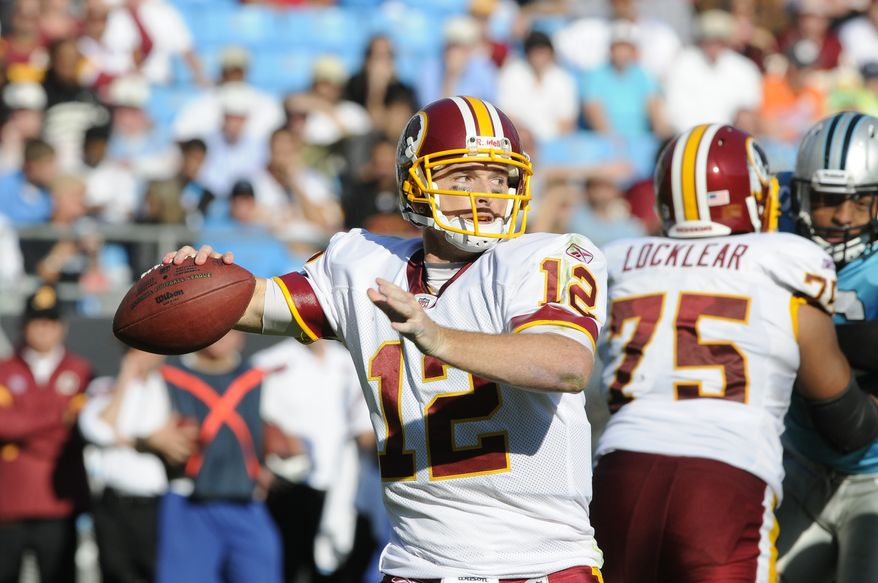 Washington Redskins quarterback John Beck threw for 279 yards and a touchdown and rushed for another in his first start of the year against the Carolina Panthers last Sunday. (AP Photo/Mike McCarn)