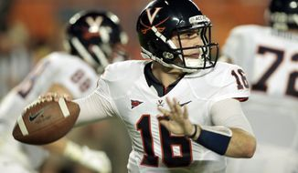Virginia quarterback Michael Rocco was 11 of 19 passing for 226 yards and two touchdowns against Miami on Thursday night. (AP Photo/Alan Diaz)