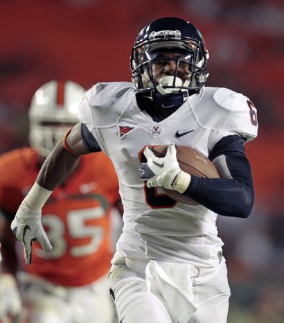 Virginia's Darius Jennings runs for a touchdown against Miami in the first quarter in Miami, Thursday, Oct. 27, 2011. Virginia held on for a 28-21 win. (AP Photo/Alan Diaz)