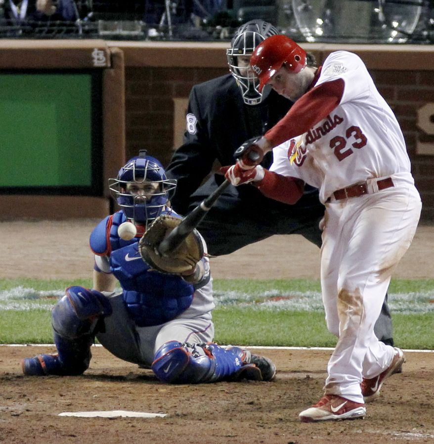 St. Louis Cardinals' David Freese hits a solo home run off a pitch by Texas Rangers' Mark Lowe in the 11th inning of Game 6 of the World Series on Thursday, Oct. 27, 2011, in St. Louis. The Cardinals won 10-9. (AP Photo/Jeff Roberson)