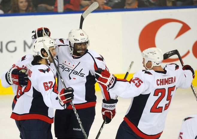 Washington Capitals' Sean Collins, Joel Ward, and Jason Chimera celebrate a goal by teammate Karl Alzner (not shown) against the Edmonton Oilers in Edmonton, Alberta, on Thursday, Oct. 27, 2011. (AP Photo/The Canadian Press, Ian Jackson)