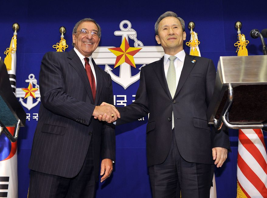 U.S. Defense Secretary Leon Panetta (left) and South Korean Defense Minister Kim Kwan-jin shake hands during a joint press conference in Seoul on Oct. 28, 2011. (Associated Press)