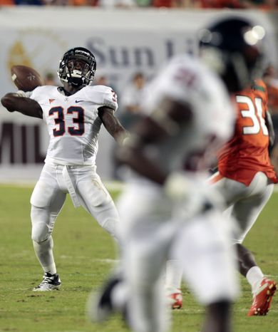 Virginia running back Perry Jones completed a 37-yard touchdown strike to Tim Smith in the second quarter. Virginia won 28-21. (AP Photo/Alan Diaz)