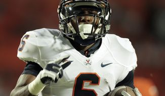 Virginia's Darius Jennings had a 53-yard touchdown reception against Miami on Thursday night. (AP Photo/Alan Diaz)