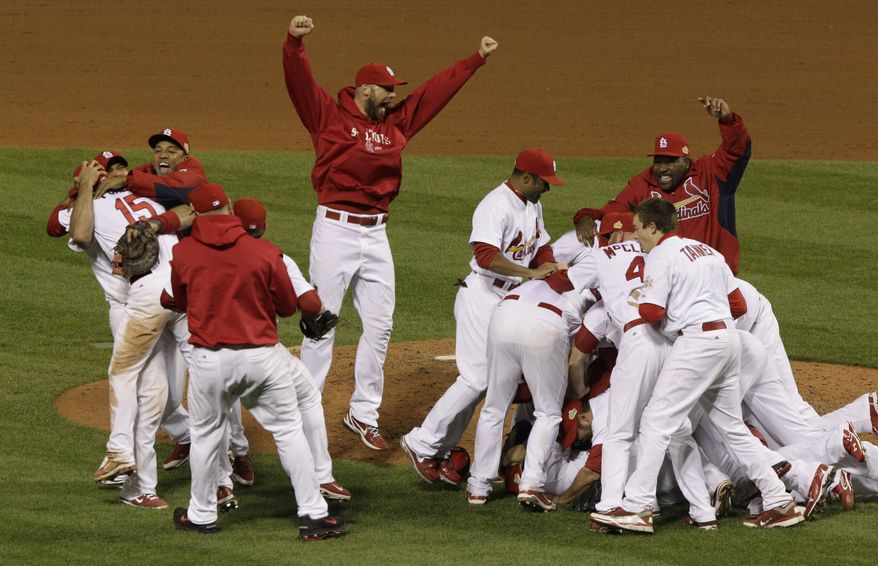 The St. Louis Cardinals celebrate after Texas Rangers' David Murphy flies out to end Game 7 of baseball's World Series Friday, Oct. 28, 2011, in St. Louis. The Cardinals won 6-2 to win the series. (AP Photo/Paul Sancya)