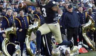 Notre Dame wide receiver Michael Floyd scored a touchdown and had 121 yards receiving in the Irish's 56-14 win over Navy on Saturday. (AP Photo/Michael Conroy)