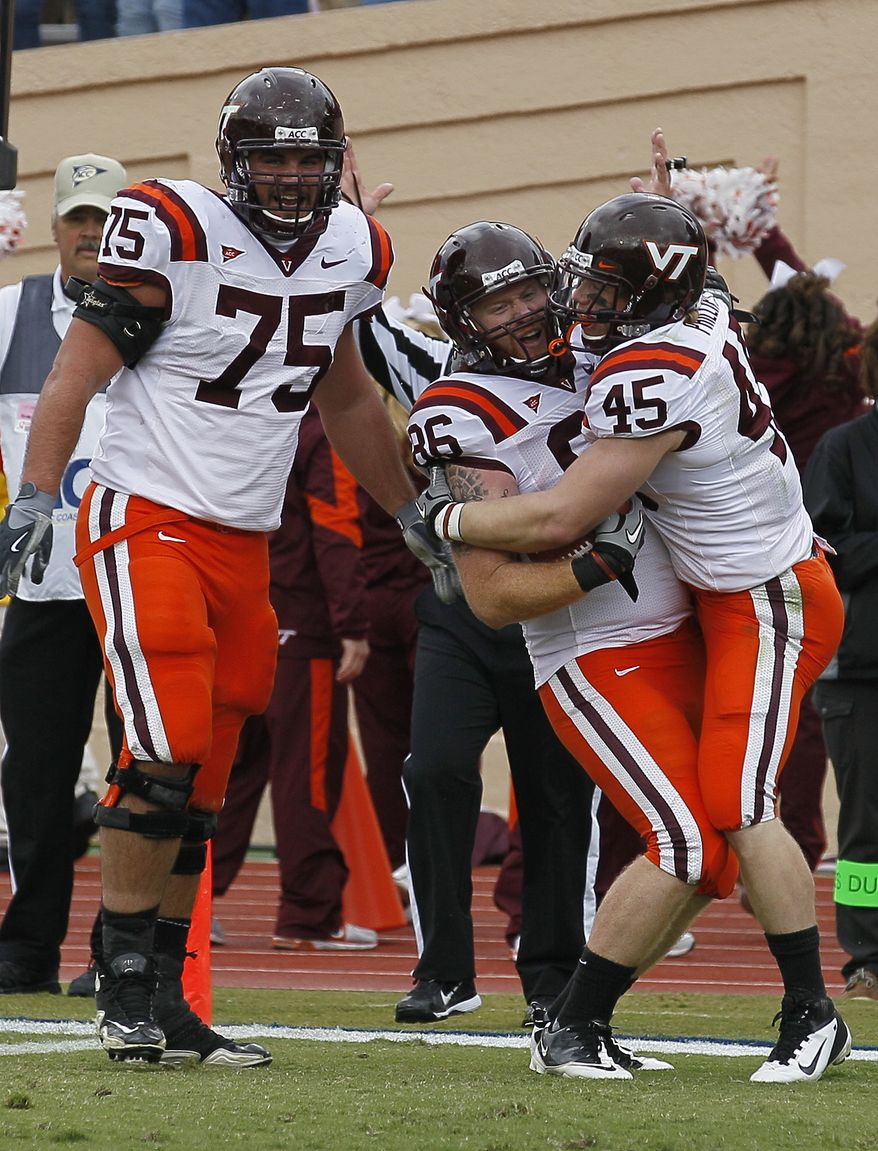Virginia Tech's Greg Nosal (75), Joey Phillips (45) and Eric Martin (86) celebrate Martin's touchdown against Duke during the first half in Durham, N.C., Saturday, Oct. 29, 2011. Virginia Tech won 14-10. (AP Photo/Gerry Broome)