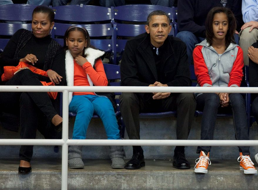 First lady Michelle Obama, seen with the president and daughters Malia (right) and Sasha, has been a bitter mood lately, heaping criticism on the Republican Party as her husband campaigns for re-election. (Associated Press)