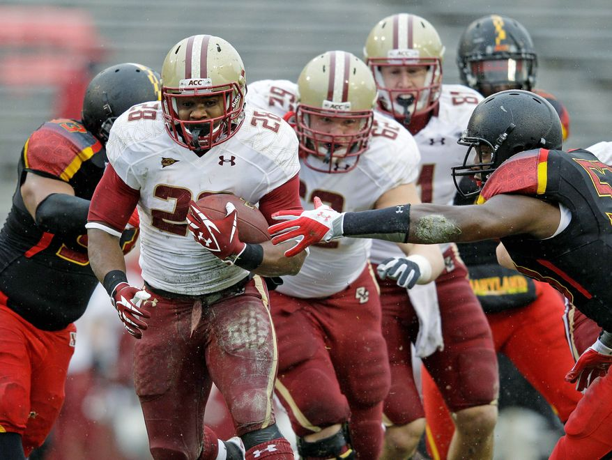Boston College running back Rolandan Finch (28) churns out some of his 243 yards during a 28-17 win over Maryland at Byrd Stadium on Saturday. Finch also scored two touchdowns. (Associated Press)