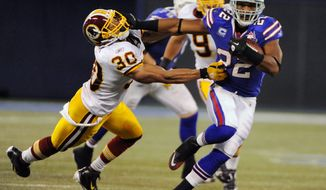 Buffalo running back Fred Jackson breaks from the grasp of Redskins safety LaRon Landry, Jackson finished with 120 yards on 26 carries. (Associated Press)