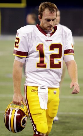 Redskins quarterback John Beck was under siege all afternoon as Buffalo racked up nine sacks. The Bills entered the game with four. (Associated Press)