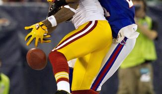 Much like this pass intended for rookie receiver Leonard Hankerson, broken up by Bills cornerback Leodis McKelvin, the Redskins had a hard time getting a handle on anything against Buffalo in absorbing their third straight defeat. (Assocaited Press)