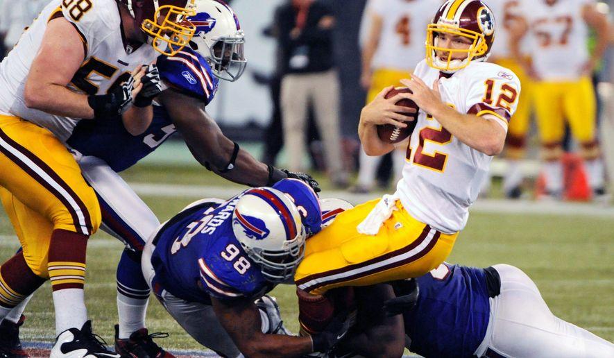 Washington Redskins quarterback John Beck was sacked nine times by the Buffalo Bills. (Associated Press)