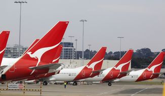 ** FILE ** The tails of Qantas planes are lined up at Sydney Airport in Sydney, Australia, on Sunday, Oct. 30, 2011. (AP Photo/Rick Rycroft)
