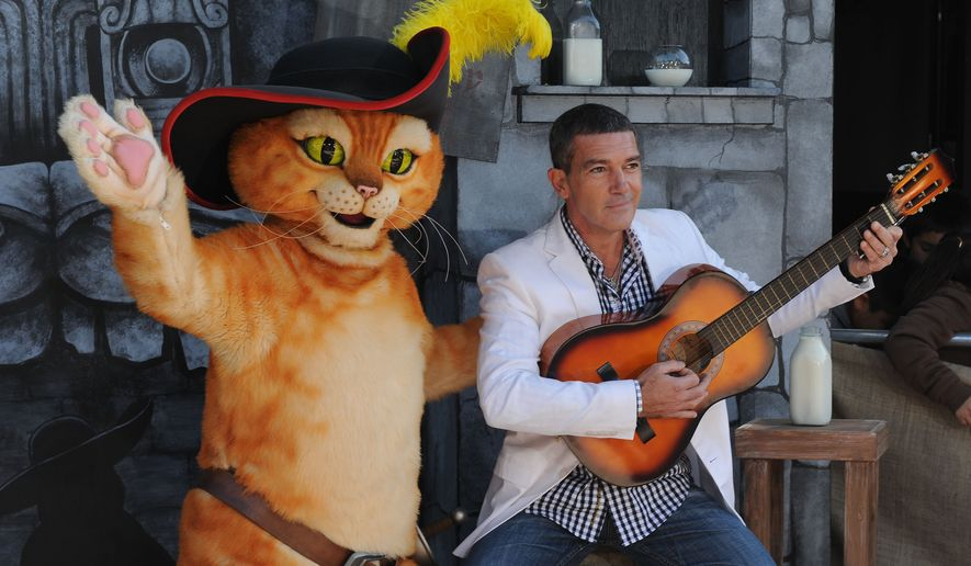 """** FILE ** Antonio Banderas arrives for the premiere of """"Puss in Boots"""" at the Regency Village Theater in Los Angeles on Saturday, Oct. 22, 2011. (AP Photo/Katy Winn, File)"""