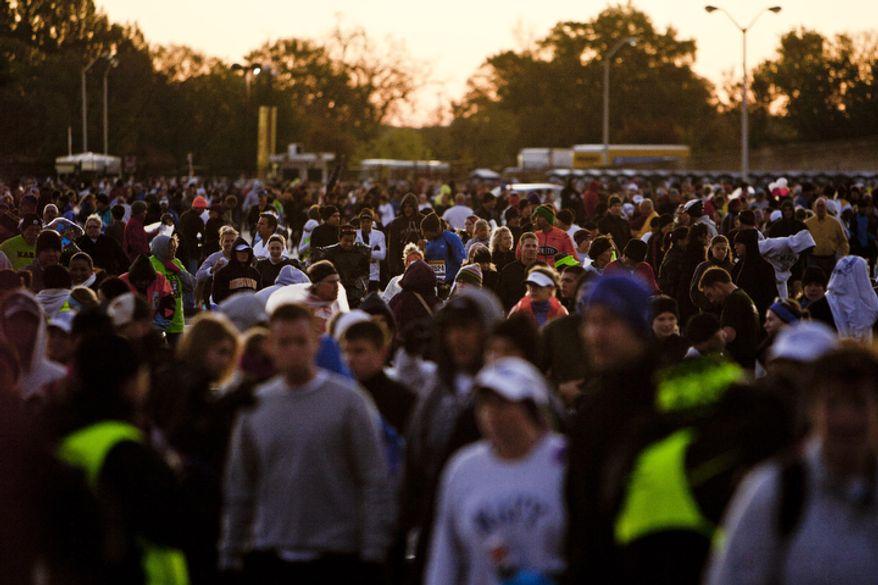 Runners make their way to the start of the the 36th Marine Corps Marathon in Arlington, Va. on Oct. 30, 2011.(T.J. Kirkpatrick/ The Washington Times)